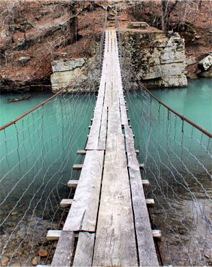 Swinging Bridge near Oark, Arkansas. © Gretchen Friedrich, 2013.